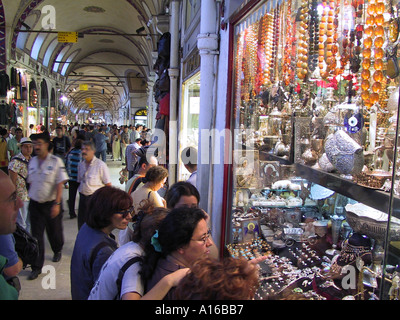 Window watchers of an antique jewelry shop in the Grand Bazaar Istanbul - 2010 European Capital of Culture - Turkey - Stock Photo
