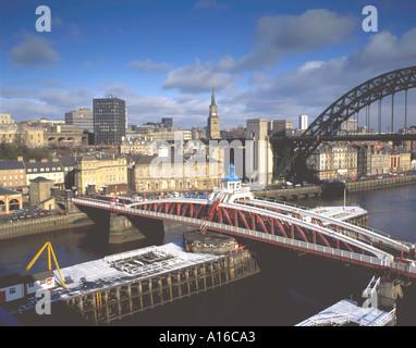 City of Newcastle upon Tyne seen over the River Tyne and Swing Bridge in winter, Tyneside, Tyne & Wear, England, - Stock Photo