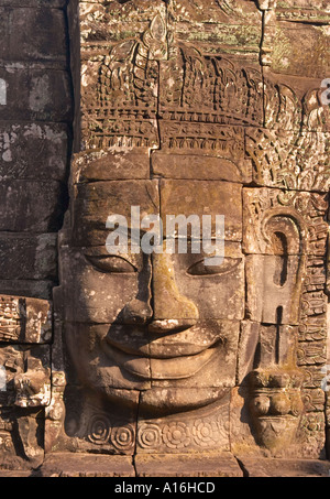 Close up of some of the Enigmatic faces at the Bayon Central tower carved with gigantic heads representing king - Stock Photo
