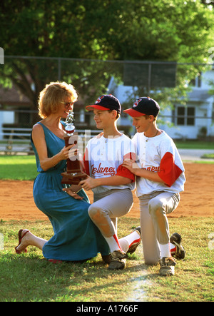 Mother congratulating her sons after baseball game - Stock Photo