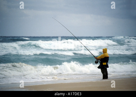 Fisherman at the beach - Stock Photo