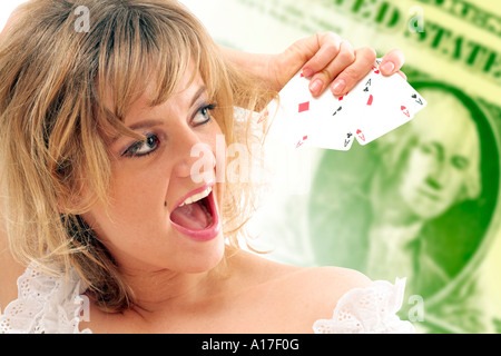 Woman showing Straight flush cards on a dollar background - Stock Photo