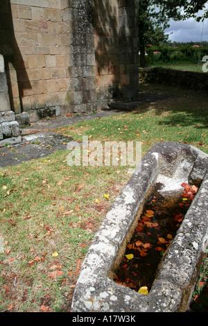 Open sarcophagus. Santa Eulalia Romanesque monastery in Vila Nova de Famalicao. Portugal. - Stock Photo