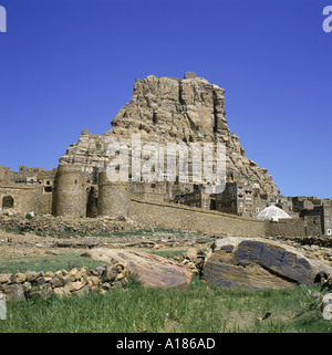 Walls and city below fortress on top of the mountain at Thulla Yemen Middle East F J Jackson - Stock Photo
