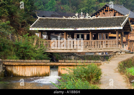 Wind and Rain Bridge in the Ethnic Minority Dong Town of Zhaoxing China - Stock Photo