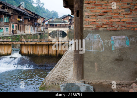 Chalk Drawings Wind and Rain Bridge in the Ethnic Minority Dong Town of Zhaoxing China - Stock Photo