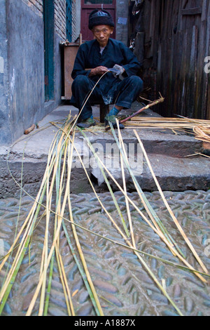 Elderly Chinese Man Prepares Bamboo for Weaving, Zhaoxing, China - Stock Photo