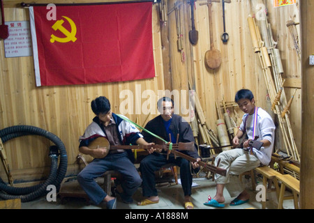 2007 Band Practicing under a Communist Flag Dong Ethnic Minority Town of Zhaoxing China - Stock Photo