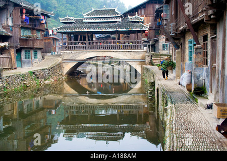 Wind and Rain Bridge During Harvest Season in the Ethnic Minority Dong Town of Zhaoxing China - Stock Photo