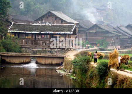 2007 Wind and Rain Bridge During Harvest Season in the Ethnic Minority Dong Town of Zhaoxing China - Stock Photo