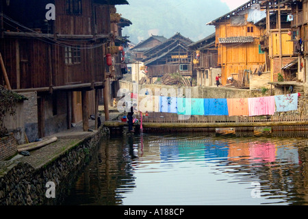 Bedding Hung out to Dry over the River Rural in the Dong Chinese Ethnic Minority Town of Zhaoxing China - Stock Photo