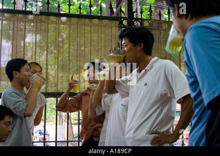 2007 Young Vietnamese People at a Bia Ahoy Bar Hanoi Vietnam - Stock Photo