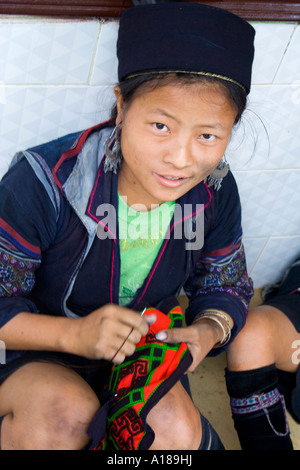 Hmong Girl in Traditional Clothes Hand Sewing Sapa Vietnam - Stock Photo