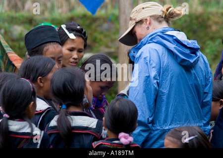 2007 Tourist Woman Conversing with Local Hmong Girls and Women in Traditional Clothing Sapa Vietnam - Stock Photo