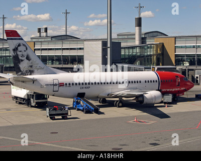 Servicing an air plane at Oslo Airport Gardermoen, OSL, located in Ullensaker, Norway - Stock Photo