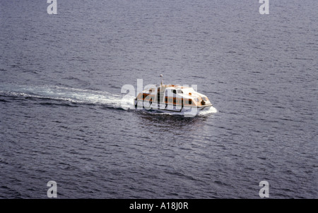 a tender from a cruise ship ferrying passengers ashore, also used as a lifeboat - Stock Photo
