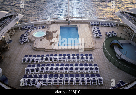 sun loungers around a swimming pool on a cruise ship - Stock Photo