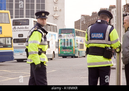 Members of the Gardai Siochana on duty in central Dublin - Stock Photo