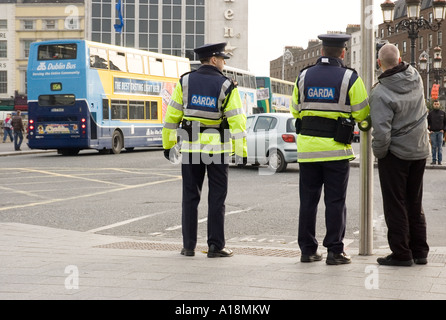 Members of the Garda Siochana on duty in central Dublin - Stock Photo