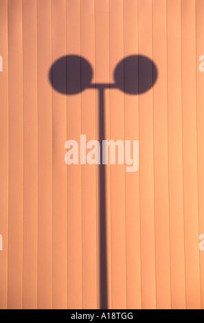 Shadow of a modern street lamp in UNO City  Vienna Austria - Stock Photo