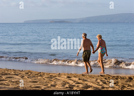 Mature couple walking on the beach in Maui, Hawaii - Stock Photo