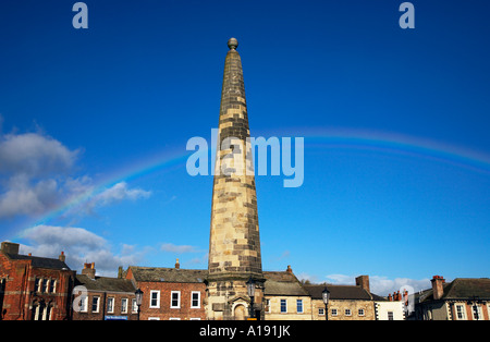 Rainbow over the obelisk in the Market Place Richmond North Yorkshire England - Stock Photo