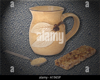 Hand crafted coffee / tea mug with spoonful of sugar and a muesli bar snack against a dark background - Stock Photo