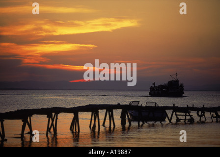 Jetty and ferry at sunset at Moyogalpa in the west of Omotepe Island Lake Nicaragua Nicaragua Central America R - Stock Photo