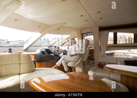 Woman looking at navigation equipment of a private luxury yacht France Europe - Stock Photo
