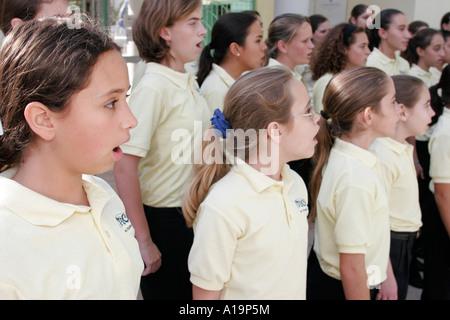 Miami Beach Florida Flamingo Park Miami Children's Chorus student group sing exercise before performance - Stock Photo