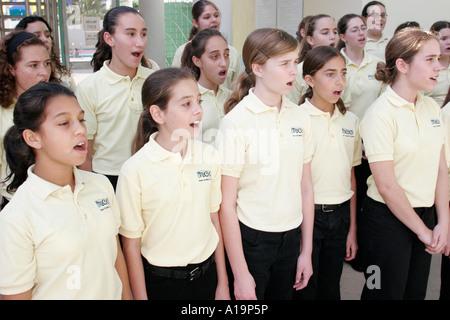 Miami Beach Florida Flamingo Park Miami Children's Chorus student group sing practice before performance - Stock Photo