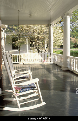 Relax: Traditional southern style front porch with rocking chairs and swing, Americus Georgia USA - Stock Photo
