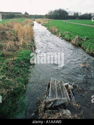 Shopping trolley in a stream - Stock Photo