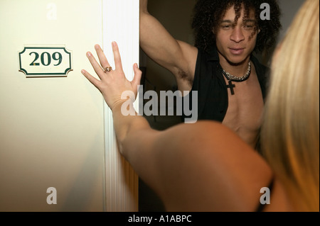 Young man opening door for a woman - Stock Photo