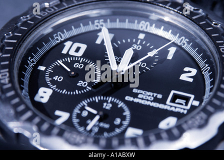 A chronograph shows five minutes before twelve, symbol for date, deadline, term - Stock Photo