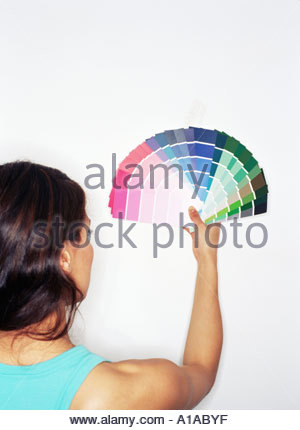 Woman holding colour swatches - Stock Photo