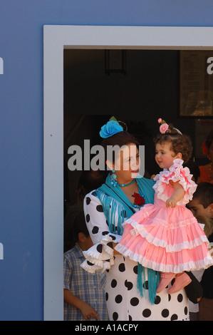 Woman with child in traje de gitana , Feria de Caballo , Jerez de la Frontera , Cadiz , Andalusia , Spain , Europe - Stock Photo