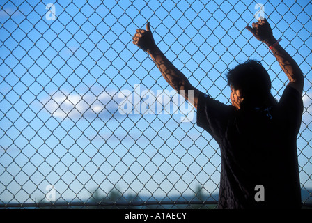 USA Alaska Fairbanks Fan watches sprint car races on dirt track at Fairbanks Speedway on summer evening - Stock Photo