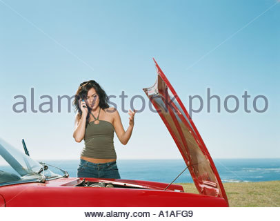 Woman having car trouble - Stock Photo