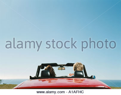 Couple in convertible - Stock Photo
