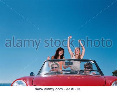 Friends enjoying road trip - Stock Photo