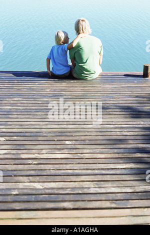 Father and son on a jetty - Stock Photo
