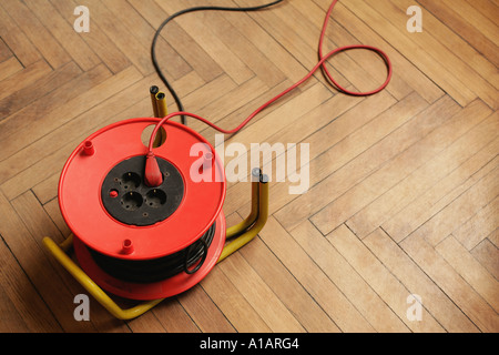 Extension cord and sockets on floor - Stock Photo