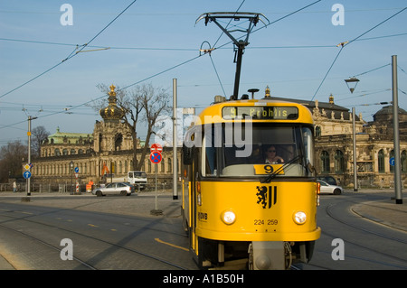 Tram passing through the old city of Dresden capital of the eastern German state of Saxony in Germany - Stock Photo