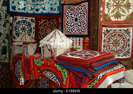 Embroidered fabric for sale at the tents maker souk in the Old city of Cairo Egypt - Stock Photo