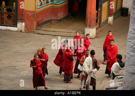 A group of novice monks gathers in the courtyard of the Paro dzong, Bhutan. - Stock Photo