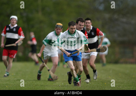 action from St Agnes v Strabane Division three club hurling GAA championship Woodlands Belfast Northern Ireland - Stock Photo