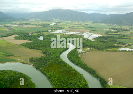 Aerial view of Australian coastline near Cairns wtih wing of small plane in view - Stock Photo