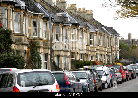 Victorian bay fronted terraced housing with cars parked outside at Combe Down near Bath Somerset England UK - Stock Photo