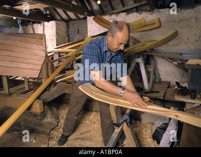 Wooden Oars being made by a craftsman in Cornwall - Stock Photo